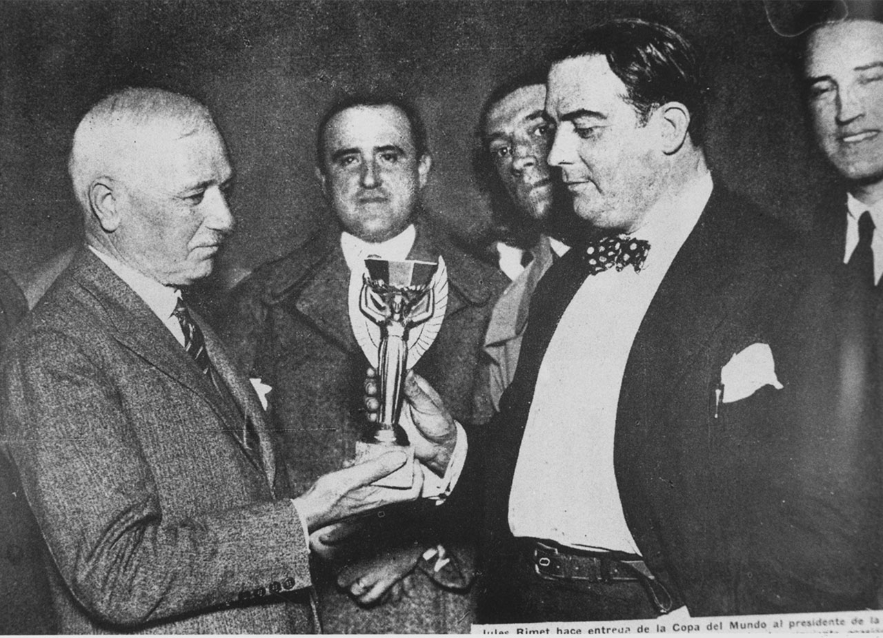 Third FIFA President Jules Rimet presents the Jules Rimet Cup to President of the Uruguayan Football Association, Paul Jude, following Uruguay's win over Argentina in the World Cup 1930 final