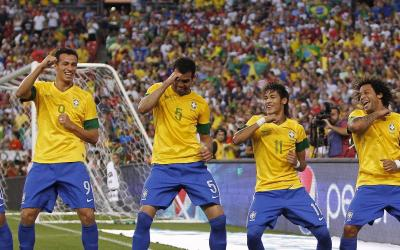Brazilian soccer players are dancing samba