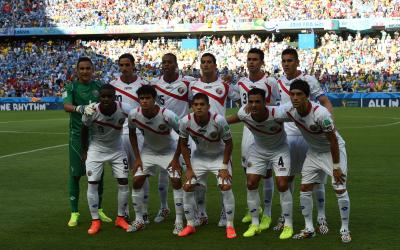 National team players pose for a group photo during a Group D