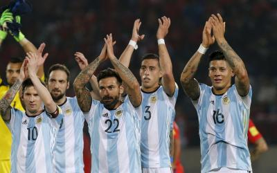Football players of the national team of Argentina are happy with the victory