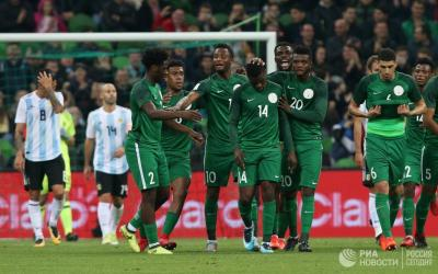 Football players of the national team of Nigeria rejoice scored goal