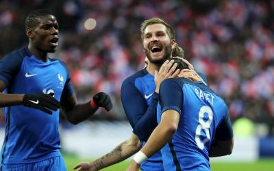 Players of the national team of France celebrate victory