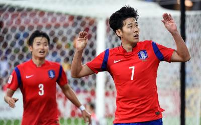 Son Hin Ming of Tottenham and Ju Hyun Joon from Porto